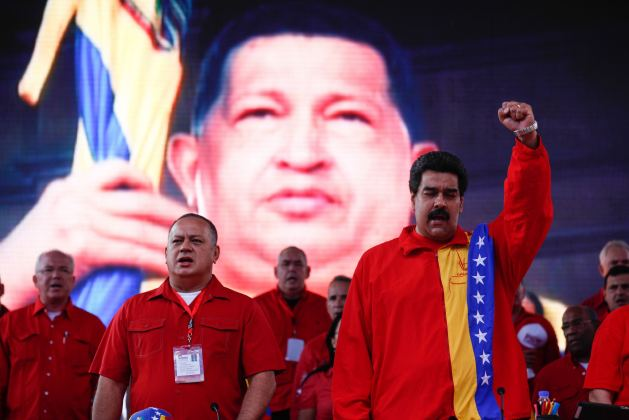 Handout picture of Maduro and Cabello singing the national anthem during the closing of the United Socialist party congress in Caracas