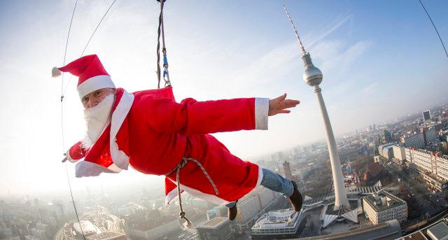 A man dressed as Santa Claus poses during a base flying event in downtown in Berlin