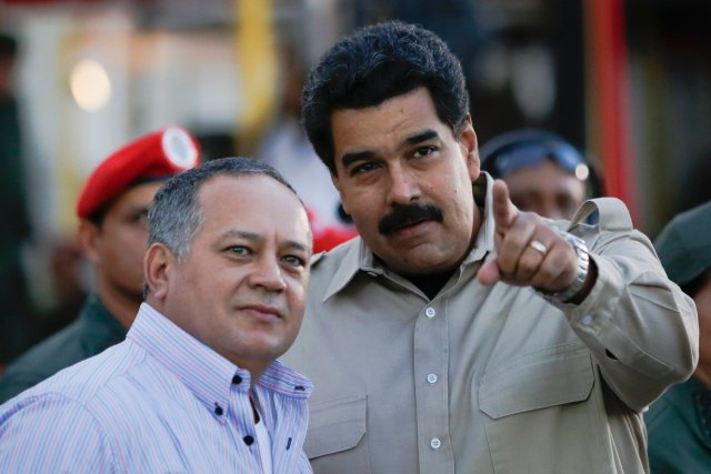 Venezuela's President Maduro talks to National Assembly President Cabello during a ceremony in Caracas