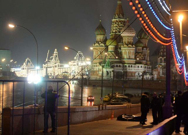 A view shows the covered body of Boris Nemtsov, with St. Basil's Cathedral seen in the background, in central Moscow