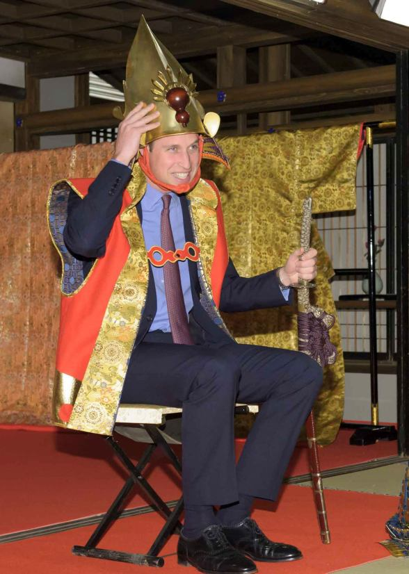 Handout photo shows Britain's Prince William trying on a samurai costume during his visit a Taiga historical drama studio set at NHK in Tokyo
