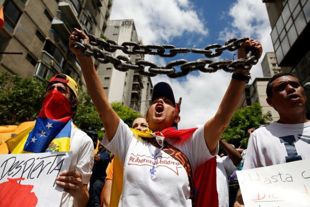 Opposition supporters shout during a gathering to protest against Venezuelan government and in support of jailed leaders Leopoldo Lopez and Antonio Ledezma in Caracas