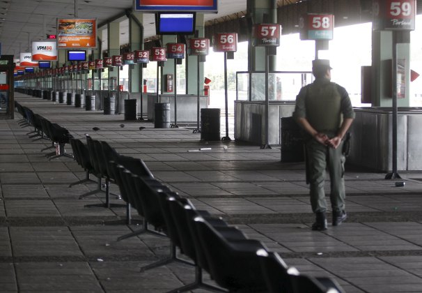 A Gendarmerie officer walks on a platform of an empty bus station during a one-day nationwide strike in Buenos Aires