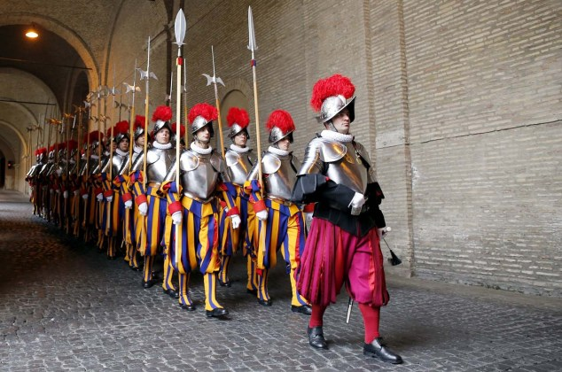 New recruits of the Vatican's elite Swiss Guard march during the swearing-in ceremony at the Vatican
