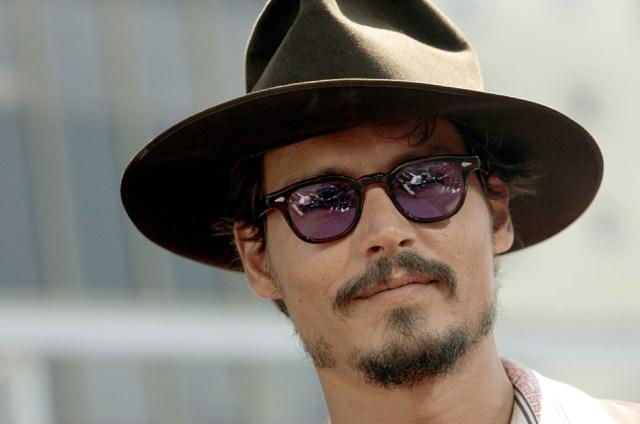 2020 07 02T124638Z 1 LYNXMPEG61164 RTROPTP 4 GBRETANA GENTE DEPP - Amber Heard afirmó que Johnny Depp tiró a Kate Moss por las escaleras cuando salían