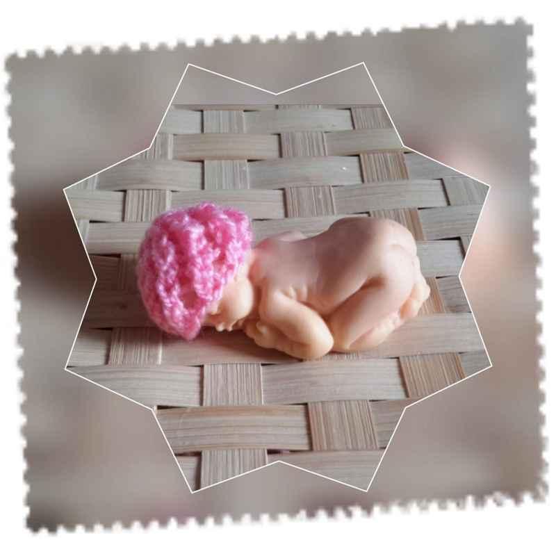 Bonnet miniature point spirale au tricot couleur au choix