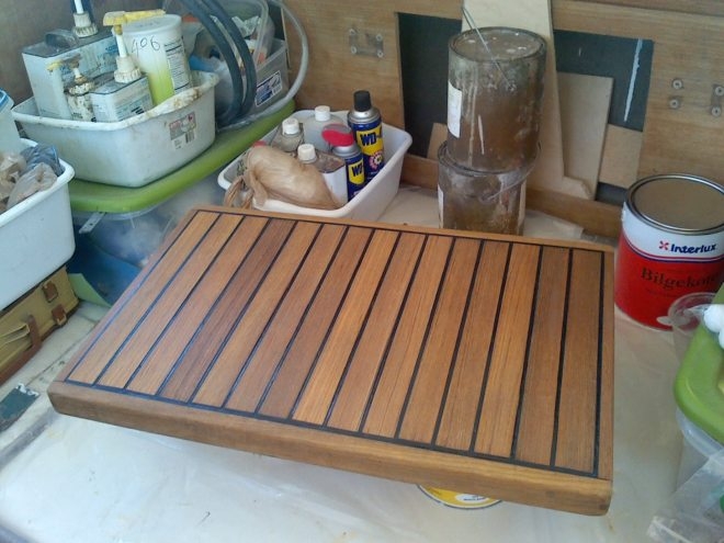 The hatch after caulking and three coats of teak sealer