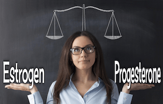 woman balance estrogen and progesterone