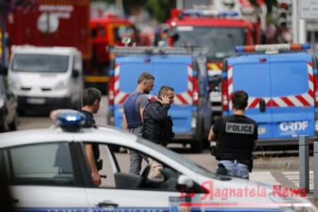 French police officers and firemen arrive at the scene of a hostage-taking at a church in Saint-Etienne-du-Rouvray, northern France, on July 26, 2016 that left the priest dead. A police source meanwhile confirmed that police killed two hostage-takers. / AFP / CHARLY TRIBALLEAU (Photo credit should read CHARLY TRIBALLEAU/AFP/Getty Images)