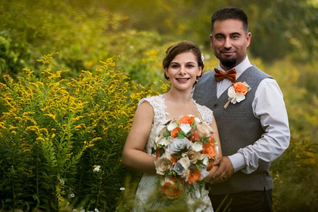 Wedding photo in golden rod at Bunnell Farm in Litchfield