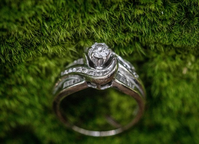 diamond engagement ring in moss