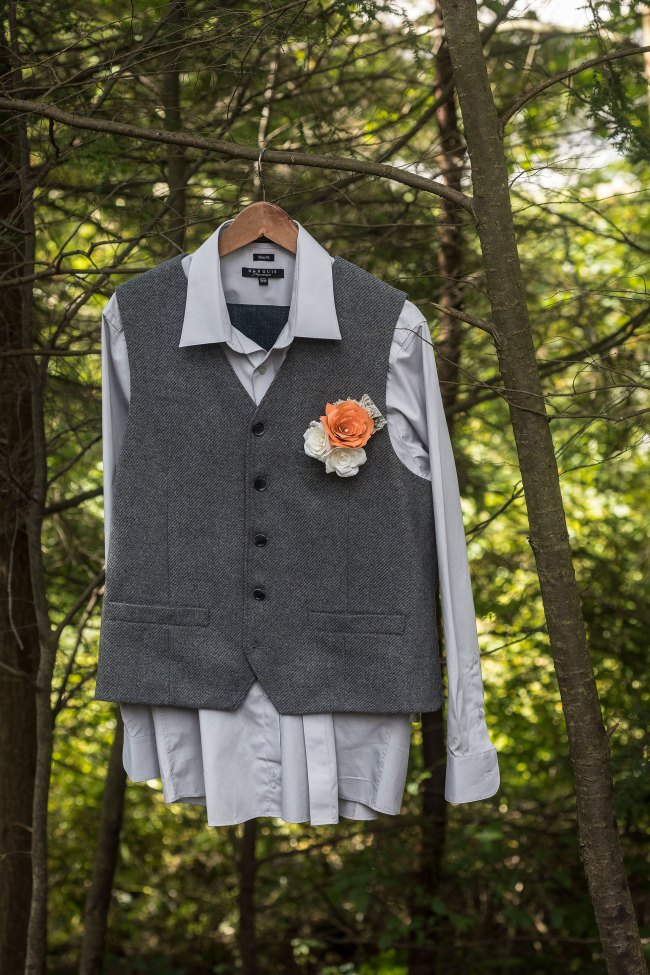 groom's vest hanging from tree