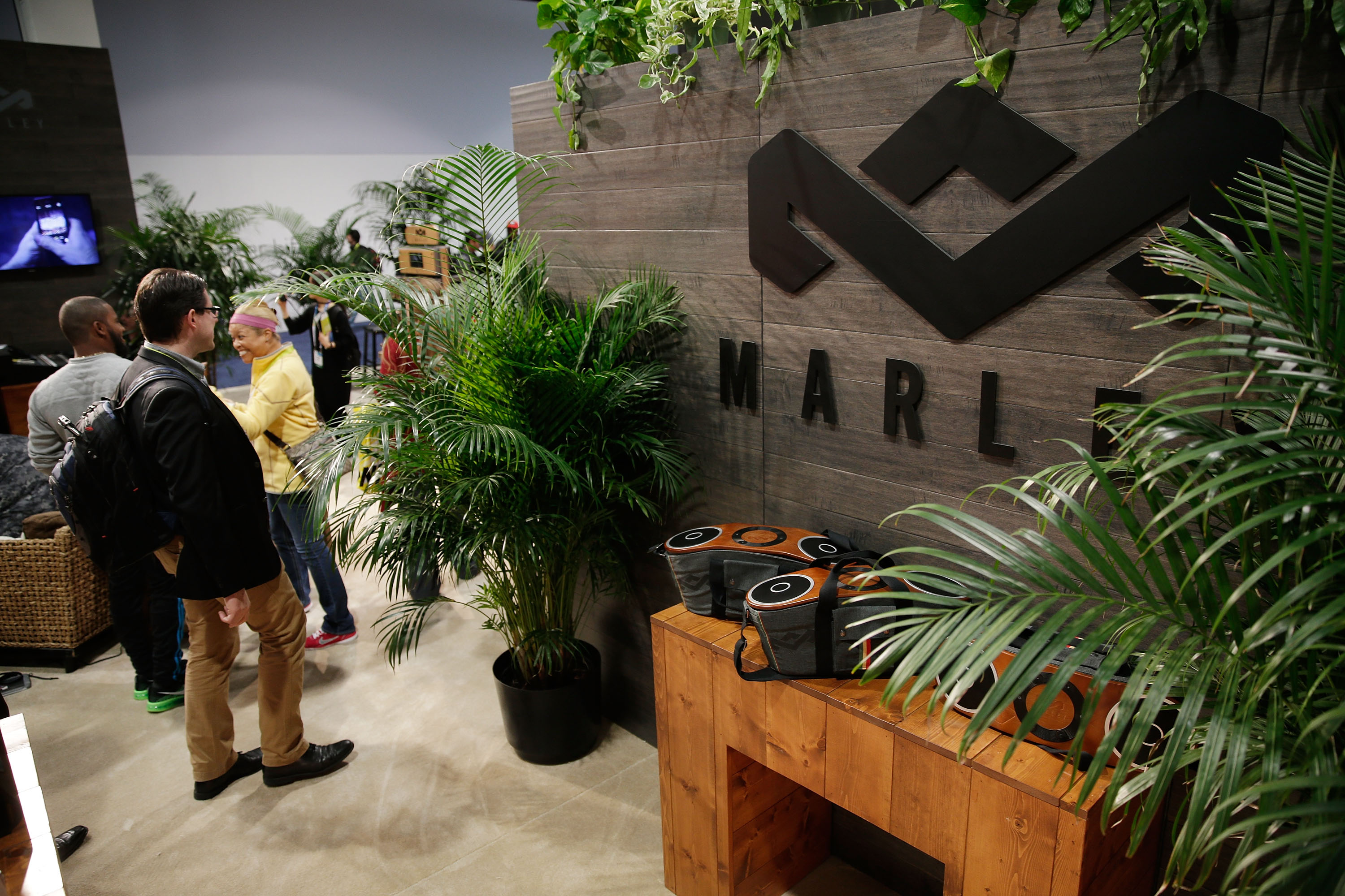 At a convention full of sterile, cookie-cutter displays, the House of Marley booth stood out with warm wood paneling, greenery and, of course, reggae sounds.