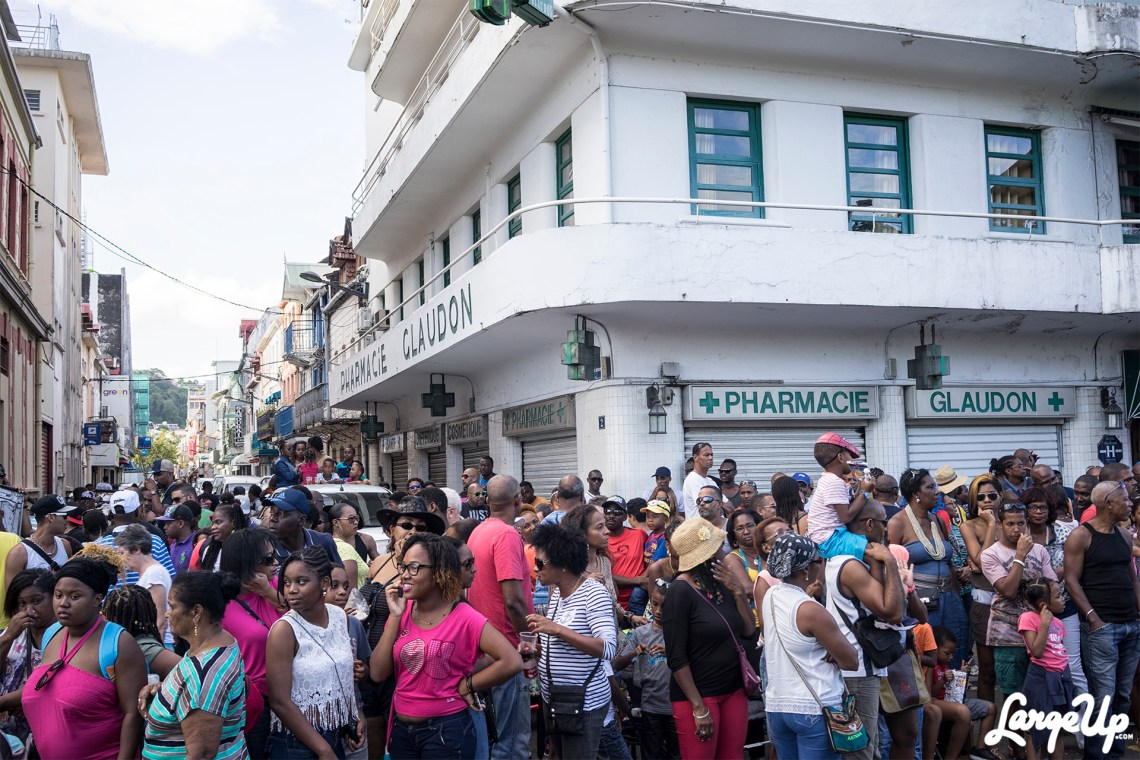 Onlookers at the Foyal Parade in Centre Ville, Fort-de-France, Martinique photo by Adama Delphine Fawundu
