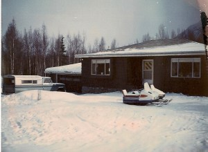 My home in Chugiak Alaska around 1970 that Dad build in 1958 with 68 Polaris out front.