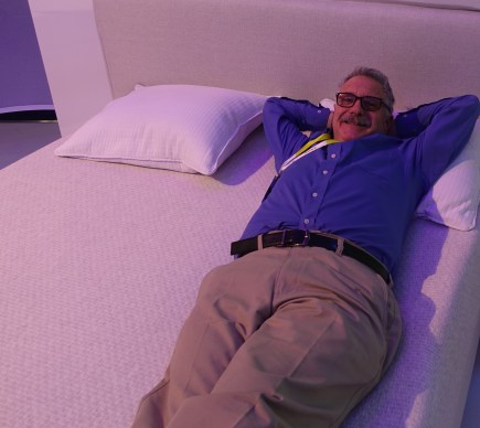 Larry sleeps on the job on a Sleep Number smart bed