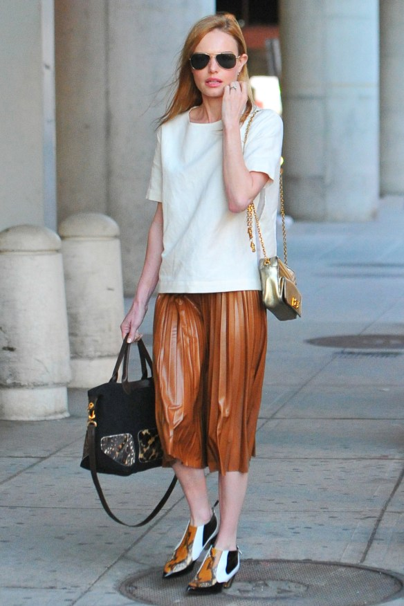 New York, NY - Kate Bosworth wore a white shirt with a brown pleated leather skirt and matching shoes.