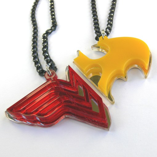 Wonder Woman Batman his and hers necklaces Laser cut from red and yellow plastic