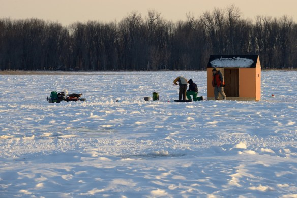Ice fishing at the end of the day