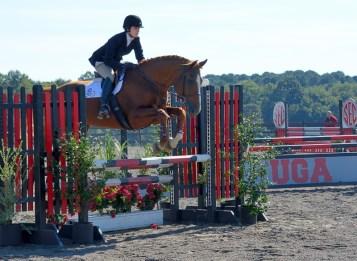 Jumping at the same equestrian meet.