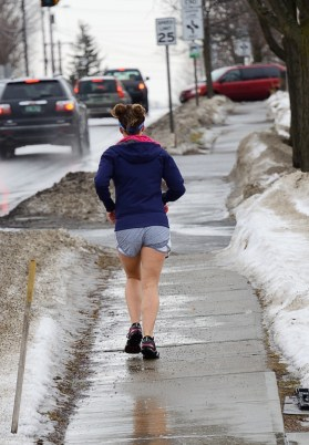 A temporary thaw brings out a young woman hoping toward summer.