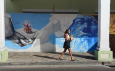 Wall mural and young woman.