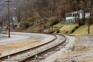 Railroads go through most towns, near streams. Homes scatter along the tracks.