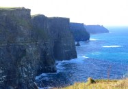 Looking south at the Cliffs of Moher, perhaps Ireland's most dramatic land-seascape. They rise nearly 400 feet above the Atlantic in County Clare. A trail at the top allows visitors to walk to the very edge and beyond, if one is careless. Unpredictable winds and rain add to the peril.