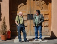 At Our Lady of Guadalupe Abbey, New Mexico, a resident brother and a worker talk in the sun.