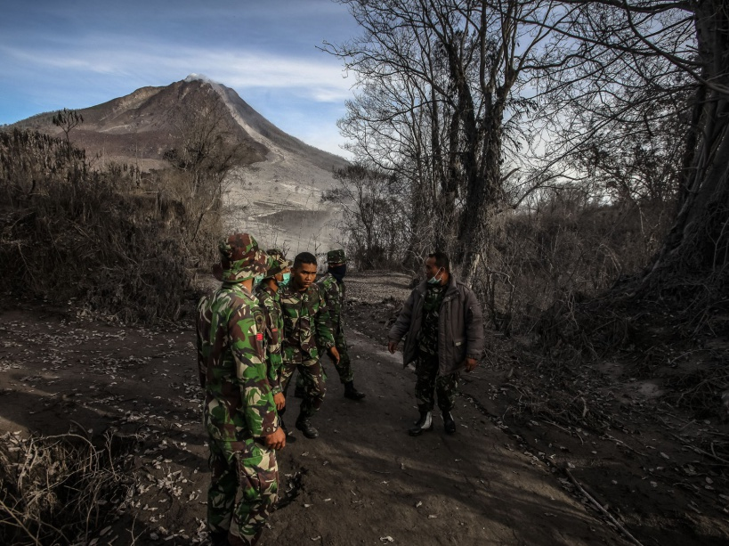 KARO, INDONESIA - MAY 22 : Indonesian soldiers inspect the village impacted by the Mount Sinabung eruption at Gamber Village, Simpang Empat, Karo, North Sumatra, Indonesia, 22 May 2016. Seven people were killed and two other were seriously wounded after Mount Sinabung volcano in North Sumatra province of western Indonesia erupted on Saturday, disaster agency official said here. YT Haryono / Anadolu Agency