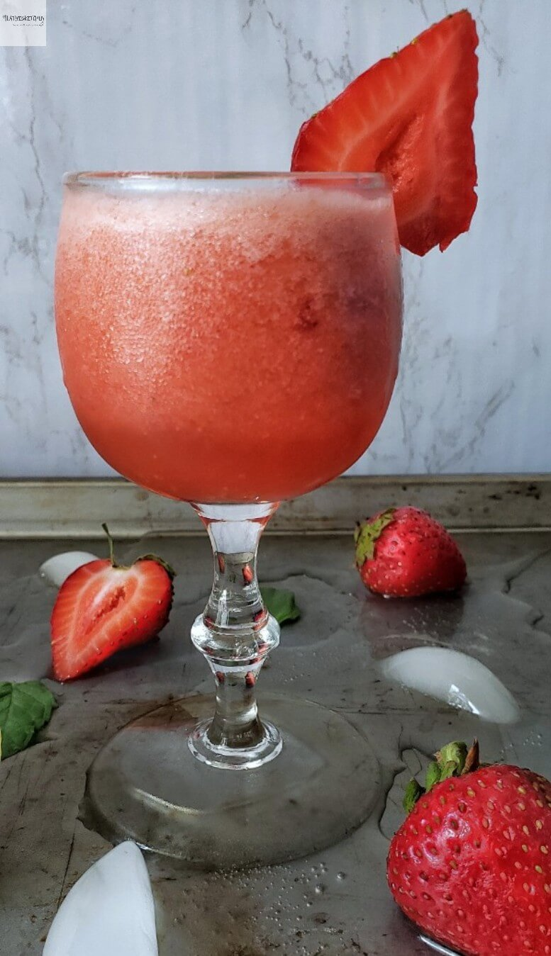 A glass of strawberry lemonade.