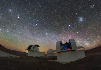 The telescopes of the SPECULOOS Southern Observatory gaze out into the stunning night sky over the Atacama Desert, Chile.