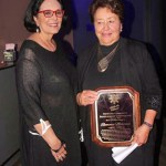Romona Martinez, Former City Council Member. Award presented by Patricia Barela, President/CEO of PBR Solutions