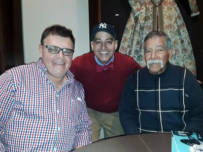 Director Jamez Vasquez (center) with his partner (left) and father (right)