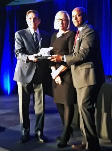 Federico Pena (left) accepts the 2018 Rex Morgan award for Lifetime Achievement