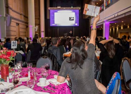 Auctioneer Jim Burz kept the fun and the money flowing raising thousands of dollars for the Mexican Cultural Center of Denver