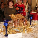 Ester Luben (center)  & friends show off her beautifully decorated table.