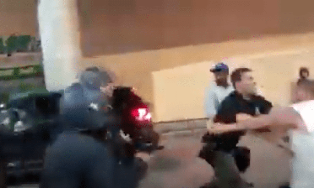 Police officer pushes protester