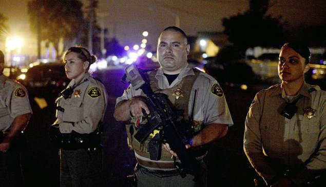 Sheriffs respond to community protest in East Salinas, assault rifles ready.