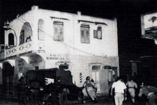 National Guard soldiers surround the Salón Boricua barbershop