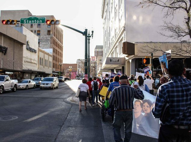 A delegation walks through Downtown El Paso. (Maria Esquinca)