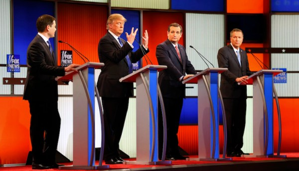 Republican presidential candidate, businessman Donald Trump, second from left, gestures as Sen. Marco Rubio, R-Fla., Sen. Ted Cruz, R-Texas, and Ohio Gov. John Kasich watch him a Republican presidential primary debate at Fox Theatre, Thursday, March 3, 2016, in Detroit. (AP Photo/Paul Sancya)