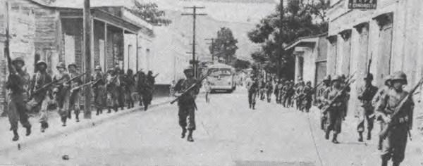 Puerto Rico National Guard troops in Jayuya, Puerto Rico, during the 1950 Jayuya Uprising. (Public Domain)