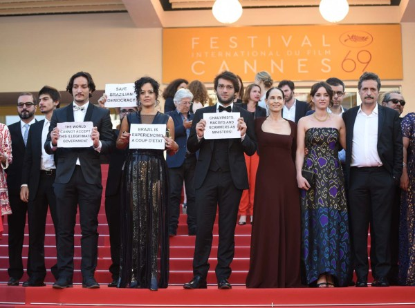 """The Cannes red carpet was the scene of an unusual political protest as the cast and crew of the Brazilian film 'Aquarius' held banners denouncing the suspension of Dilma Rousseff as a 'coup d'etat."""""""