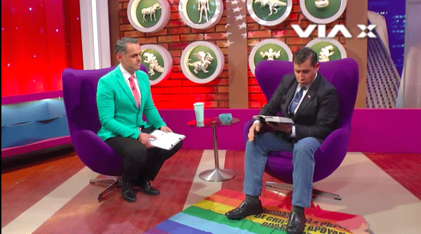 Evangelical Pastor From Chile Uses LGBTQ Flag as Carpet and Calls It 'Filthy Rag'