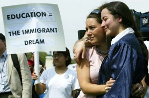 WASHINGTON - APRIL 20:  Ana Maria Archila (R) and Carly Fox, of the New York State Dream Act Task Force, hold each other during a mock graduation ceremony at the West Front of the U.S. Capitol April 20, 2004 in Washington, DC. Several hundred students and advocates took part in the ceremony and urged Congress and the Bush administration to pass the Dream Act, which would put U.S.-raised immigrant students on the path to college and U.S. citizenship.  (Photo by Alex Wong/Getty Images)