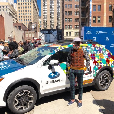 Guerra in front of his Dining Out For Life-wrapped Subaru at Philly's Food Truck Pop Up.