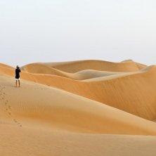 Deserts - Tourist walking in the desert, Sharqiyah Sands, Ash Sharqiyah, Oman