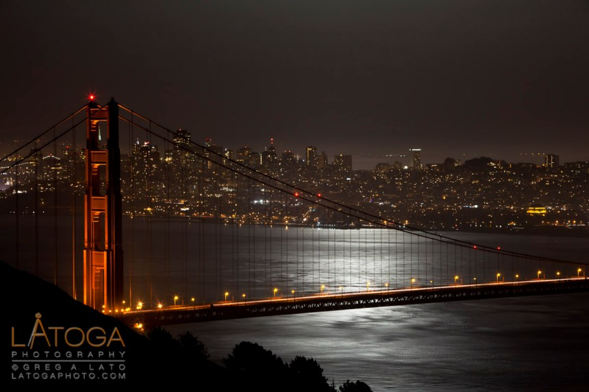 May 2012 Super Moon reflection in San Francisco Bay with Golden Gate Bridge and San Francisco Skyline as seen from Marin Headlands.