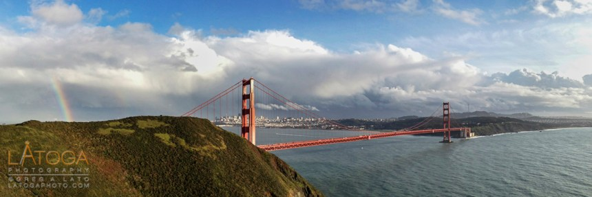 A breaking winter storm creates a rainbow next to the Gold Gate Bridge as seen from Marin Headlands.